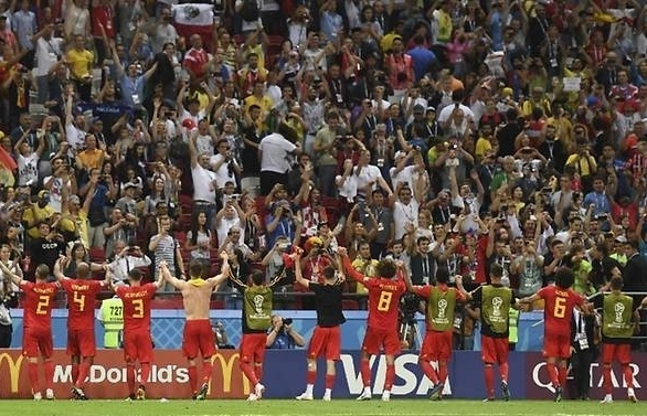 world cup belgium hold off brazil fightback to reach semi finals