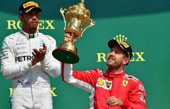 formula one vettel edges hamilton to win british grand prix