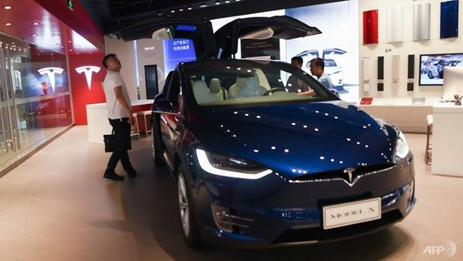tesla unveils shanghai factory plans amid us china trade row
