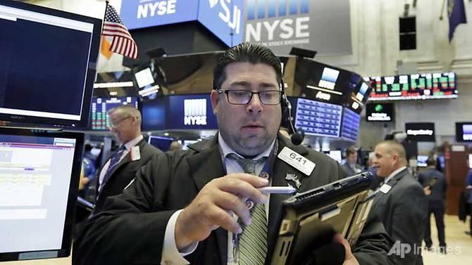 nasdaq jumps 14 to close at new record ahead of big us earnings