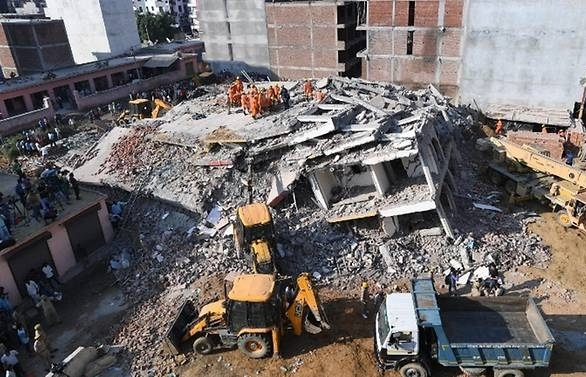 death toll from india building collapse hits nine