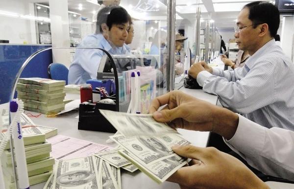 Investors watching on weakened yuan