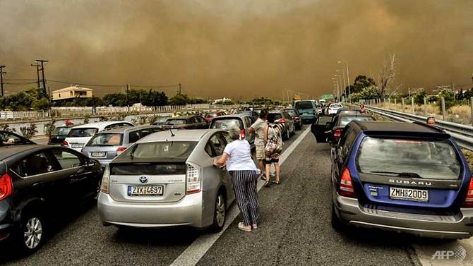 greece in mourning as horrifying wildfires kill 74