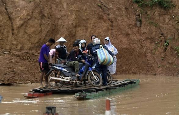 rains hamper search for survivors after laos dam collapse