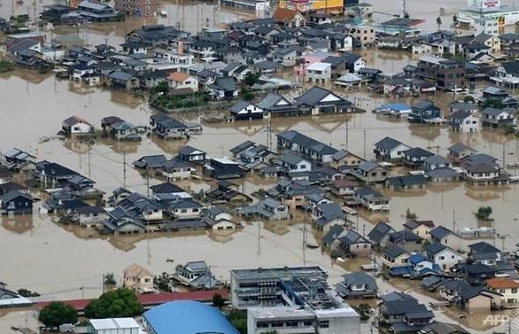 typhoon barrels towards flood hit western japan