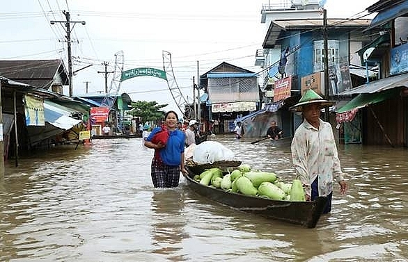 floods force thousands from homes in myanmar
