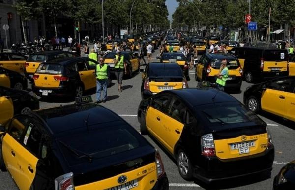 madrid taxis join barcelona strike against uber