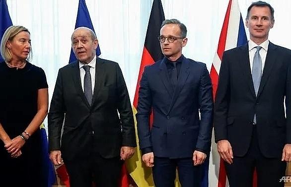 eu france germany and uk urge iran to reverse uranium decision