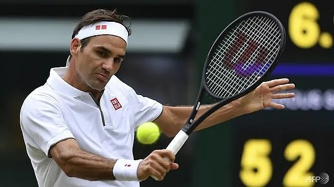 federer posts new slam record as favourites cruise into wimbledon last 16