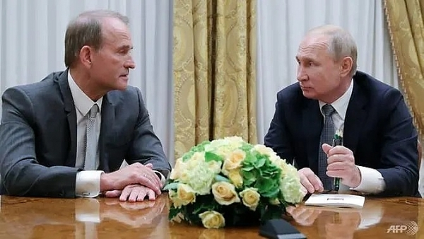 putin says will work to restore ukraine ties