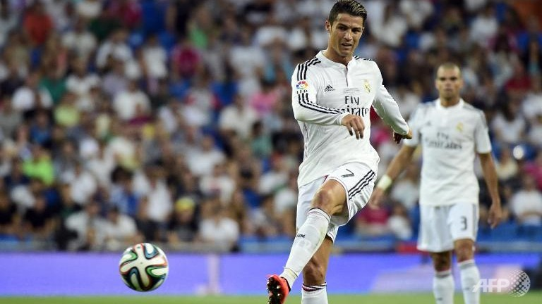Real Madrid off to winning start, Atletico held