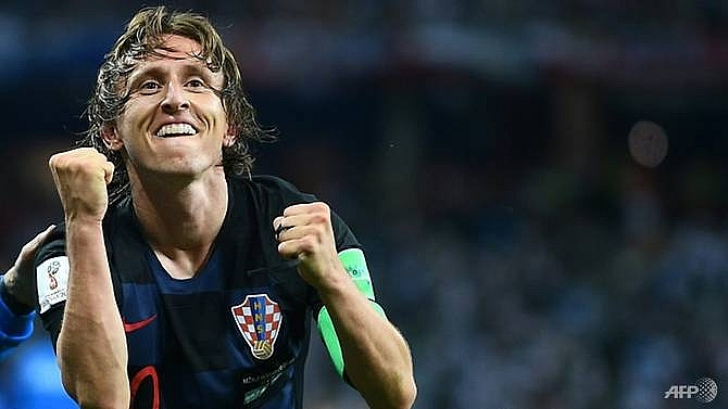 modric returns to real madrid training amid doubts over future