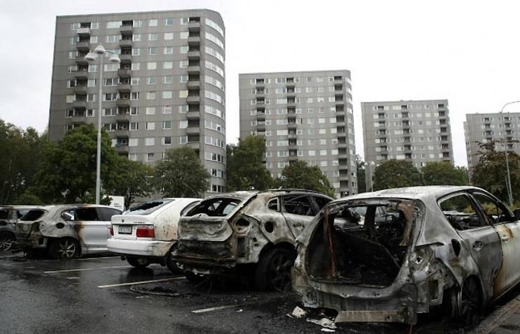 masked vandals torch dozens of cars in sweden