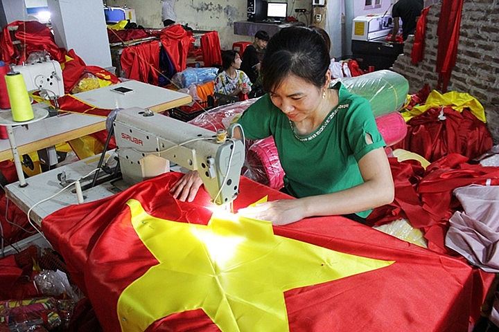 flag makers sewing up a storm before national day
