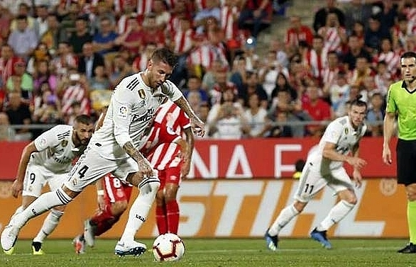 bale and benzema in the goals as real madrid survive scare