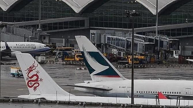more than 100 flights cancelled at hong kong airport