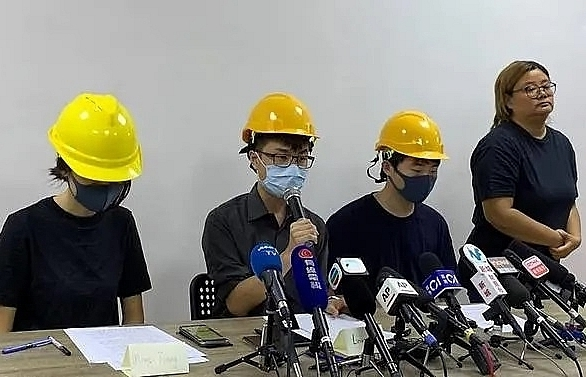 masked hong kong protesters hold rare press conference