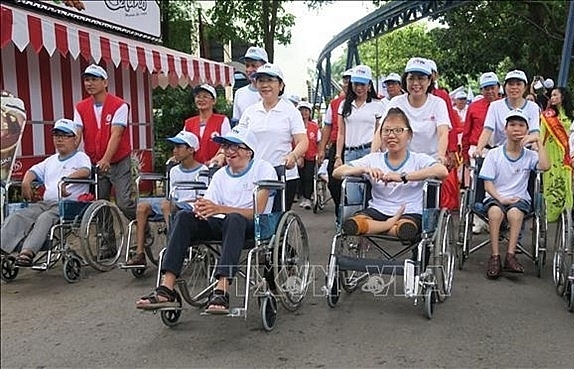 thousands walk for ao victims people with disabilities