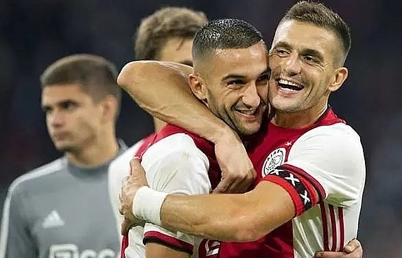 ajax see off paok to reach champions league playoffs