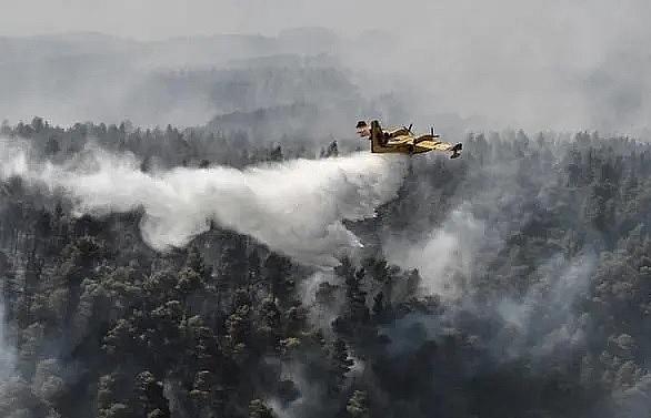 eu water bombers join greek firemen to douse island wildfire