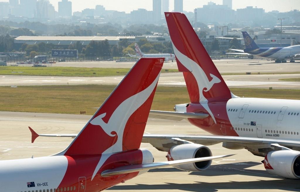 australias qantas posts us 19 bn loss confirms job cuts