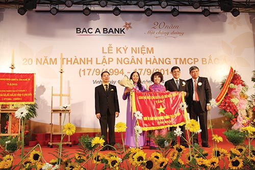 bac a bank raises glass to 20 years