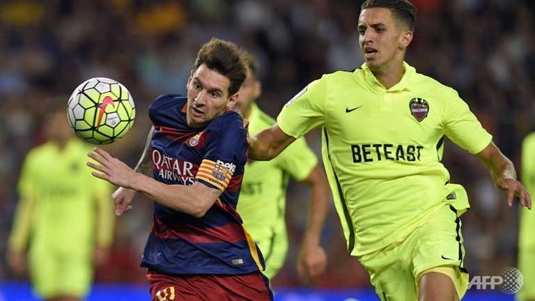 Messi's double takes Barcelona back top of La Liga