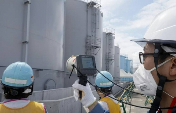 japan confirms first fukushima worker death from radiation