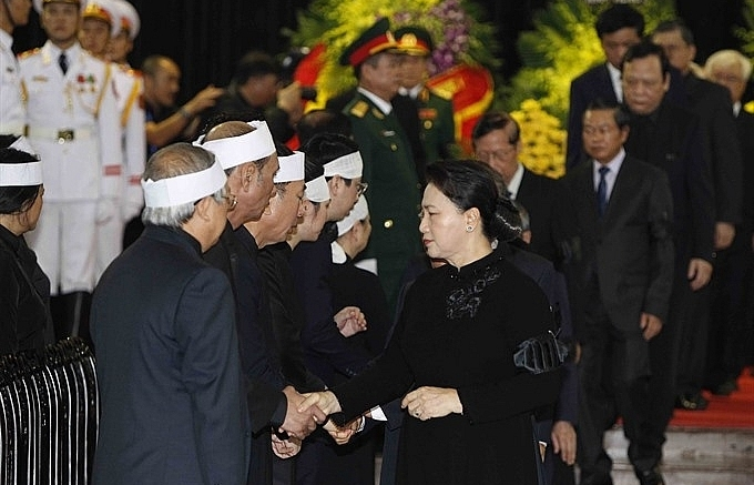 party state na govt leaders pay tribute to president quang