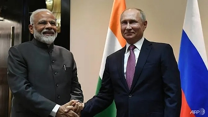putin modi vow closer ties at far east economic forum