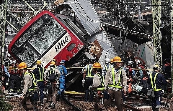 1 dead more than 30 injured after train and truck collide in japans yokohama