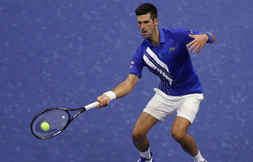 djokovic marches on at us open with straight sets win