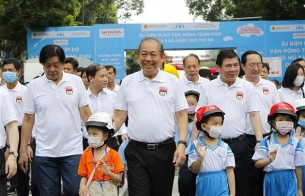 deputy pm calls for more children wearing helmets