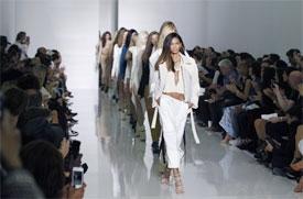 Kanye West makes fashion debut in Paris