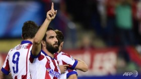 Turan strike hands Atletico vital win over Juventus
