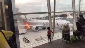 Fire breaks out near passenger jet at Hong Kong airport, 1 injured