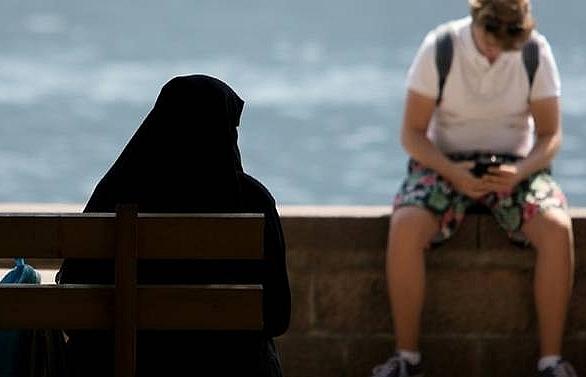 enforcing austrias burqa ban a delicate matter in alpine resort