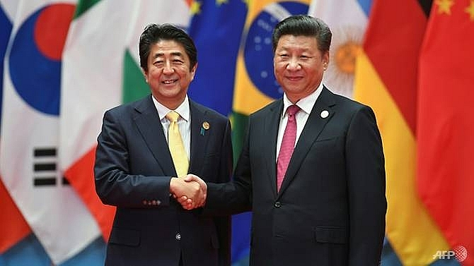 japan pm abe to make rare china visit