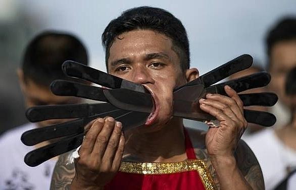 ouch thailands cheek piercing vegetarian festival