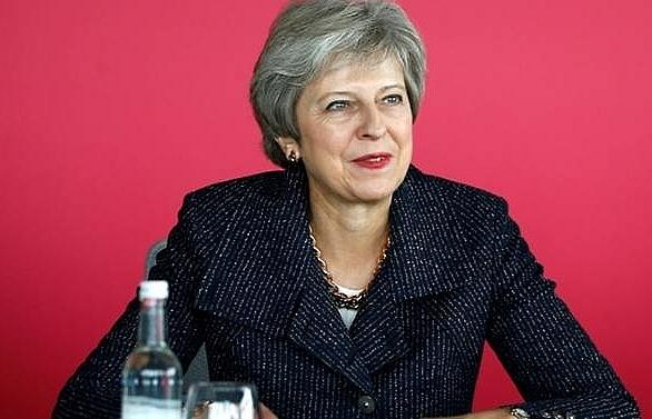 uk pm faces backlash over brexit compromise