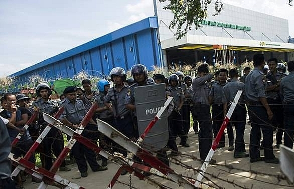 clashes at myanmar garment factory leave dozens injured