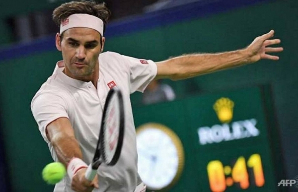 federer reveals long standing hand injury