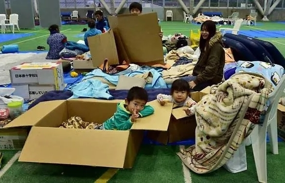 58 dead rescuers in day and night hunt for missing after japan typhoon