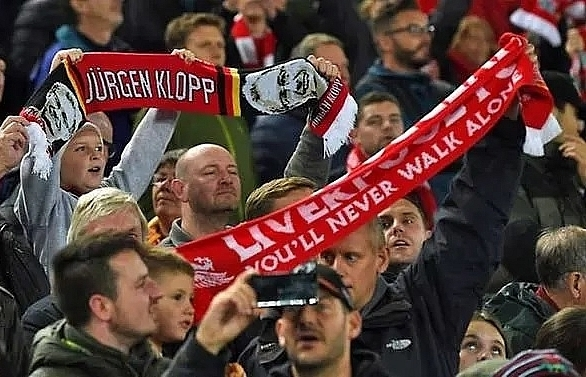 uefa fine liverpool man city for fan misconduct