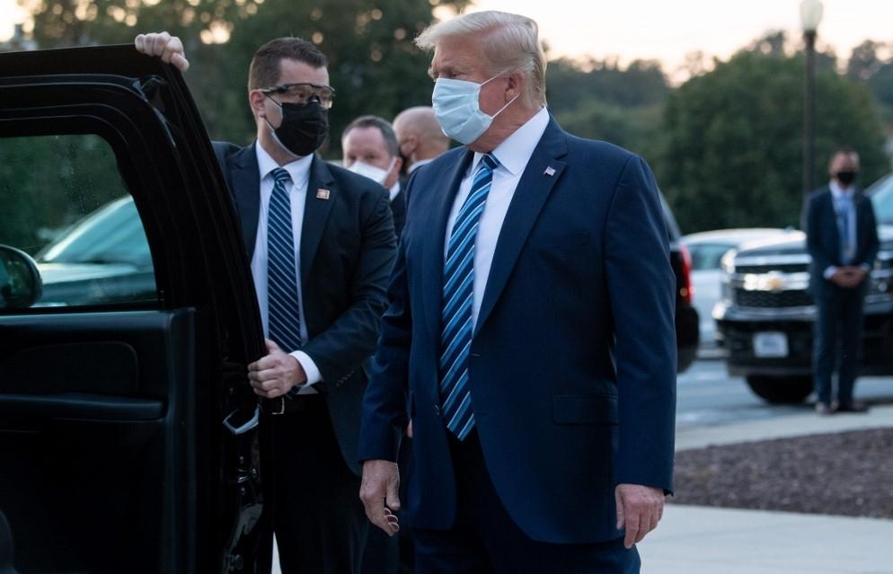 trump leaves hospital for white house removes mask immediately