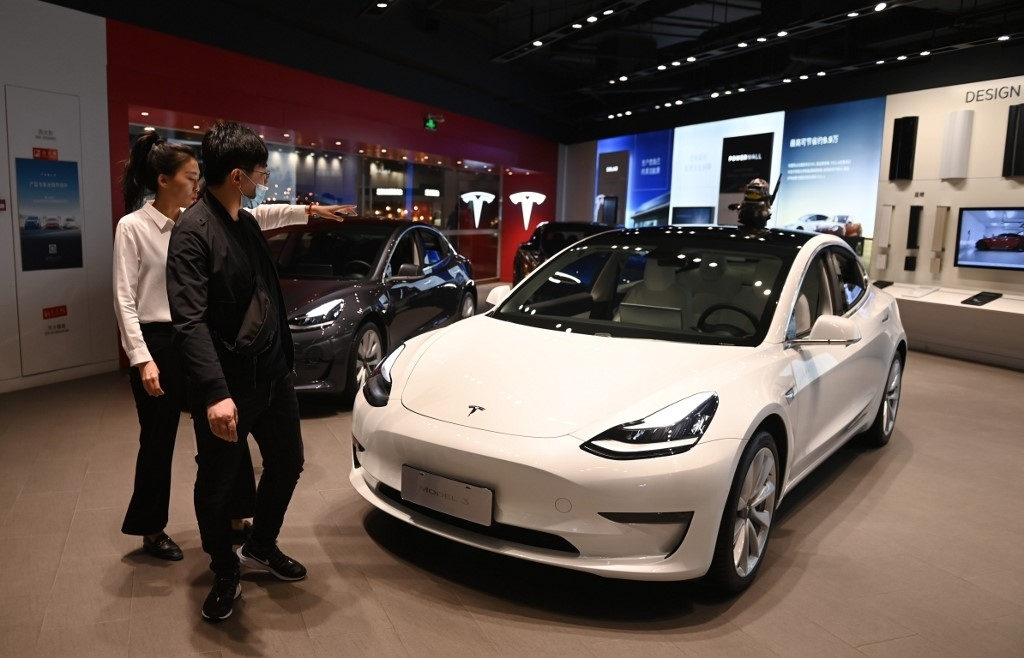 tesla to recall 30000 cars from china over suspension defects
