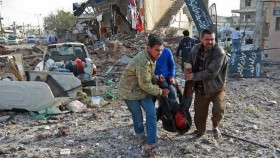 Air raids on market kill 53 in north Syria town