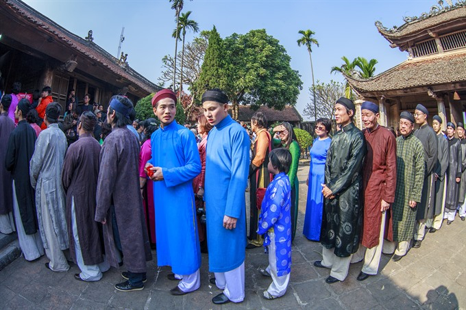 artists ambassadors bringing back ao dai for men