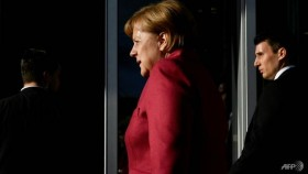 Merkel's fate in balance as German coalition talks drag on
