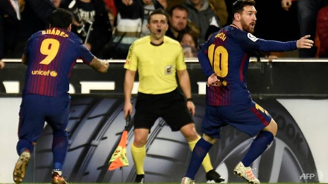 valencia hold barca amid messi ghost goal controversy